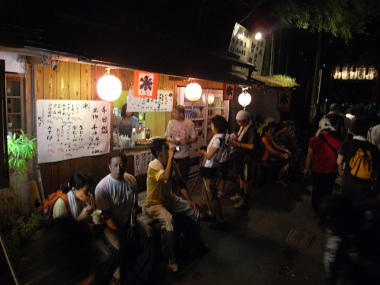 There is a vendor selling noodles and beer at the Torii gate where you started your trek.