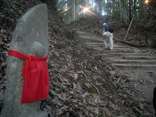Jizo stone statues are placed all along the mountain path.